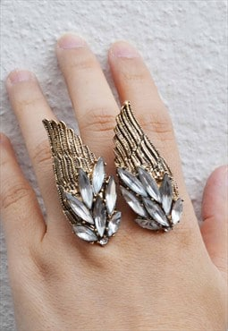 Funky wing with clear stone ring