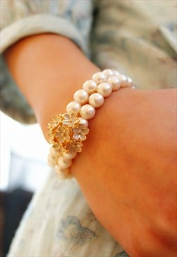 Pearl Ball Bracelet with White Floral design