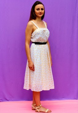 1980s vintage white floaty dress with yellow print detail