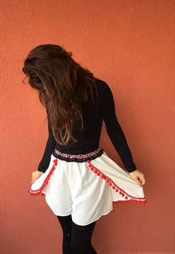 Ethnic  motif box shorts  with pompoms and embroidery
