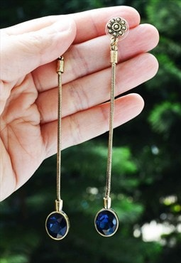 Dangling blue stud earring