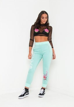 Sakura slim fit blossom print joggers in mint green