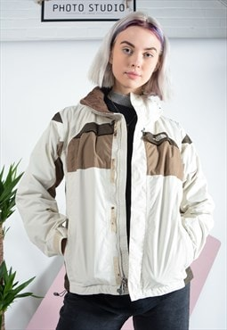 Vintage North Face outdoor jacket in cream.
