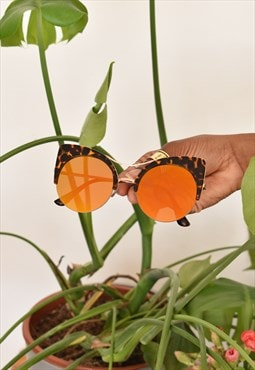 Orange mirror sunglasses with tortoiseshell style frames