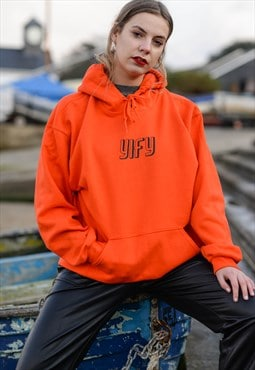 oversized YIFY logo hoodie in orange.