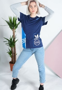 Vintage Adidas t-shirt in blue with logo.