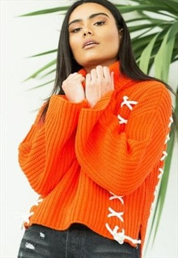 Orange turtle neck knit with cross lace detail