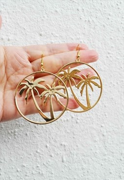 Gold palm earring