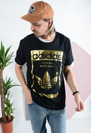 Vintage Adidas t-shirt with metallic design in black.