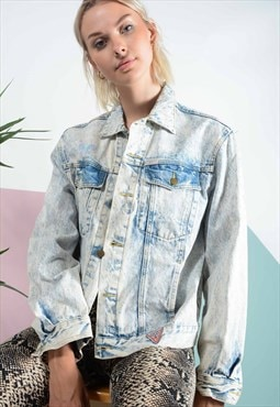 Vintage acid wash denim jacket in blue.