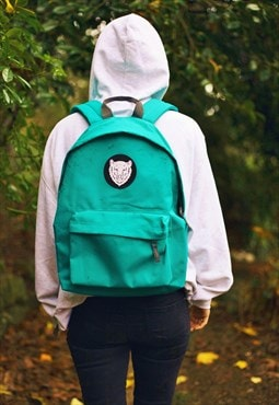 Everyday teal rucksack with Outsiders bear design patch