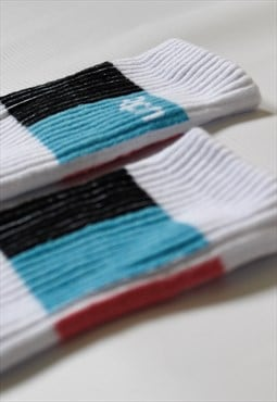 white sports socks with light blue, pink & vertical stripes
