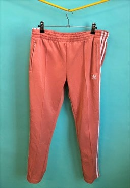 Vintage Adidas tracksuit bottoms in salmon pink