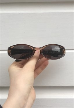 Womens Vintage 90s oval Gucci sunglasses in bronze brown