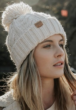 Cable Knitted Bobble hat in Cream