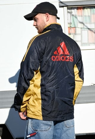 ADIDAS GOLD AND BLACK CLIMAPROOF SPORTS WEAR JACKET