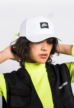 Cap in White with Green Neon Toggle and Embroidered Patch.