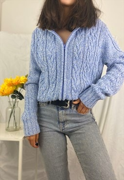 Blue cable knit zip up hooded cardigan.