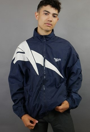 NAVY & WHITE REEBOK LOGO SPELL OUT SHELL SUIT JACKET
