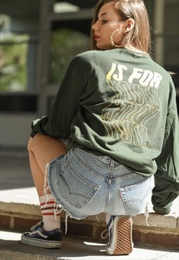 Long sleeve t-shirt in green with back print.