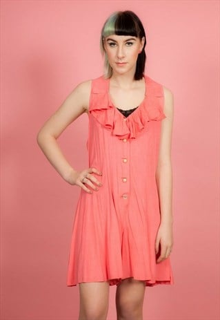 VINTAGE CORAL PINK FRILLY PLAYSUIT WITH LARGE PEARL BUTTONS