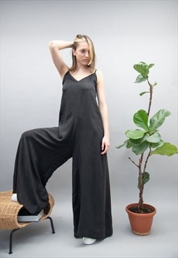 Loose leg, open back with pockets jumpsuit with deep v line