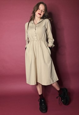 Stunning vintage military style dress in beige
